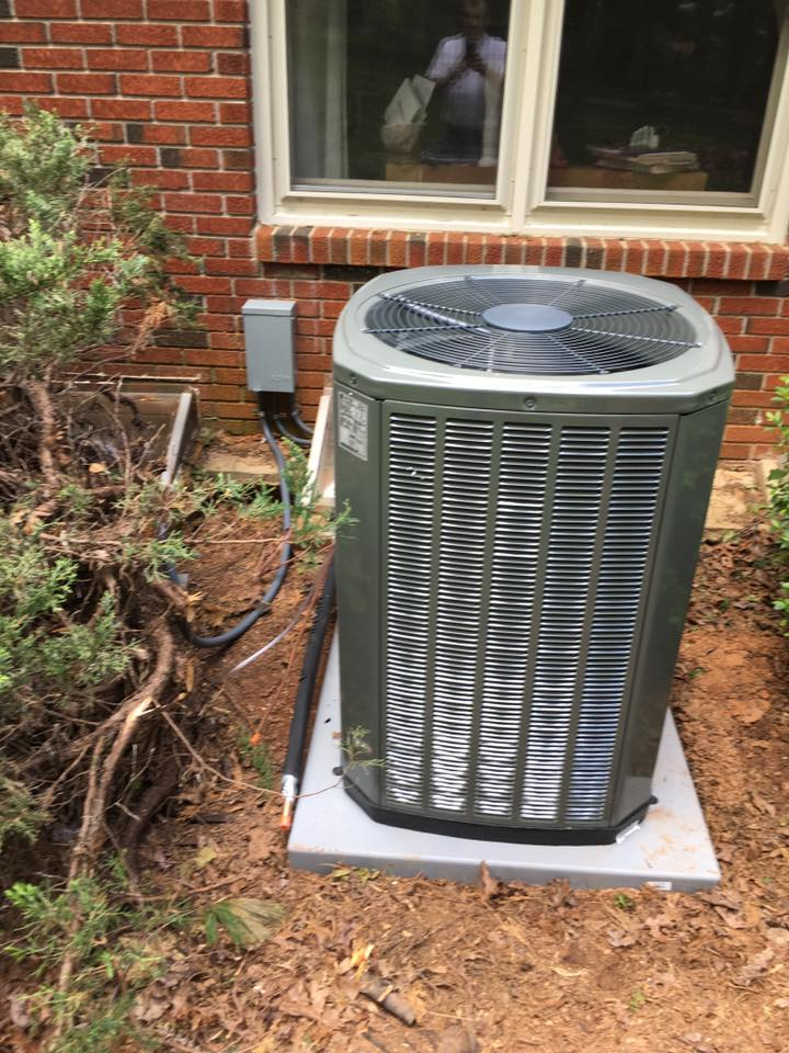 CAM Heating & Cooling HVAC unit outside a home